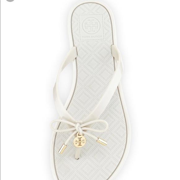 e96a11c47e7c50 Tory burch jelly bow logo charm thong sandals. M 5b0da7d7b7f72b1cf7537b3f